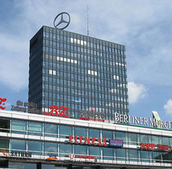 Europa Centre in Berlin Germany uses a Volkwagen engine to rotate the Mercedes Benz Start on it's roof top.