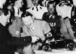 Hitler examining a model of the first Volkswagen